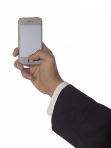 4287082-a-hand-holding-cellphone